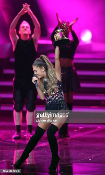 US singer Ariana Grande performs on stage during the Bambi Award ceremony at the Stage Theater on Potsdamer Platz inBerlin Germany 13 November 2014...
