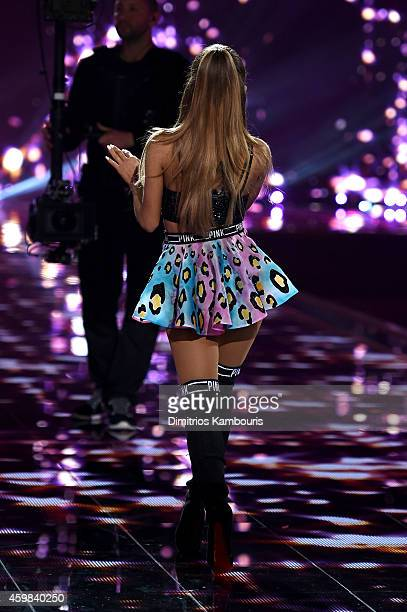 Singer Ariana Grande performs on the runway during the 2014 Victoria's Secret Fashion Show at Earl's Court Exhibition Centre on December 2 2014 in...