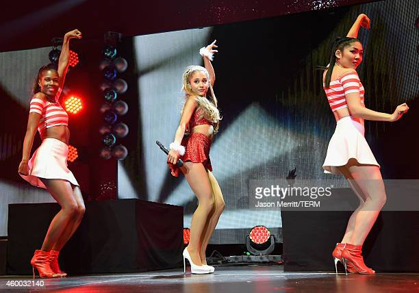 Singer Ariana Grande performs onstage during KIIS FM's Jingle Ball 2014 powered by LINE at Staples Center on December 5 2014 in Los Angeles California