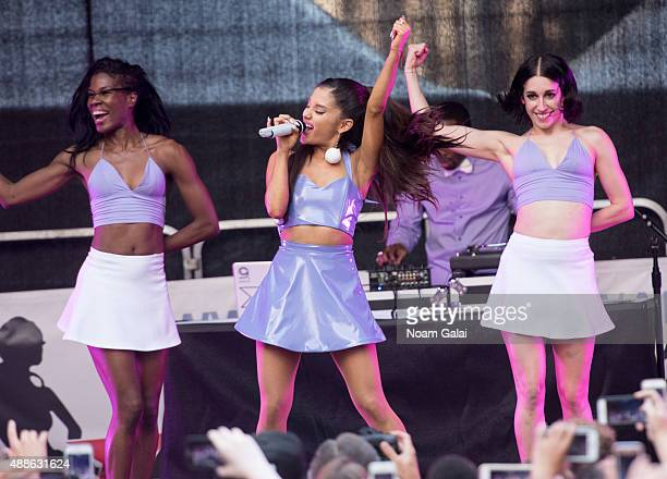 Singer Ariana Grande performs outside of Macys Herald Square at an 'ARI By Ariana Grande' fragrance launch event on September 16 2015 in New York City