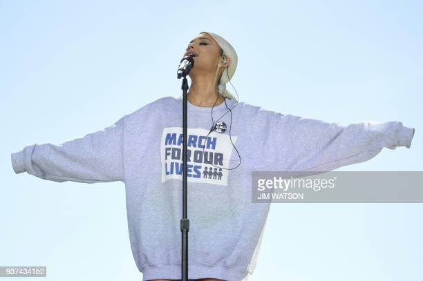 Singer Ariana Grande sings during the March for Our Lives Rally in Washington DC on March 24 2018 Galvanized by a massacre at a Florida high school...
