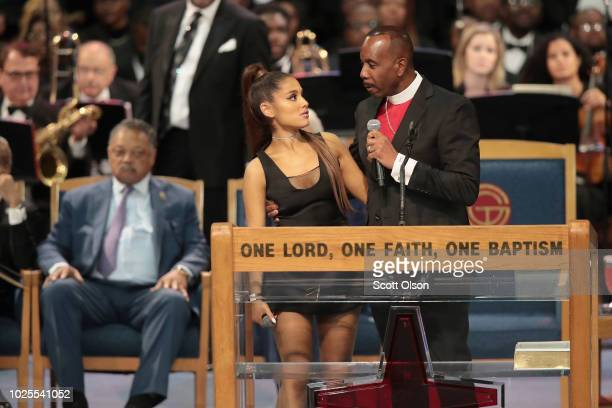 Singer Ariana Grande speaks with Bishop Charles Ellis III after performing at the funeral for Aretha Franklin at the Greater Grace Temple on August...