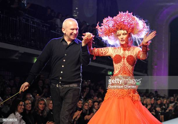 Singer Arielle Dombasle and Designer JeanPaul Gaultier greet the audience during the JeanPaul Gaultier Haute Couture fashion show as part of the...