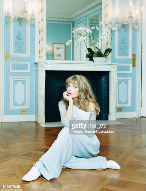 Singer Arielle Dombasle is photographed for Madame Figaro on December 5, 2007 in Paris, France. Sweater , pants , shoes . PUBLISHED IMAGE. CREDIT...