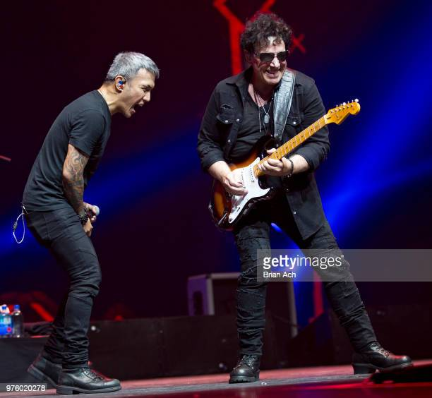 Singer Arnel Pineda and founder and guitarist Neal Schon of the band Journey are seen at Prudential Center on June 15 2018 in Newark New Jersey
