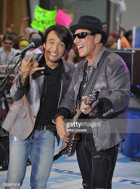 Singer Arnel Pineda and guitar player Neal Schon of the band Journey performs at the 2011 Today Summer Concert series at Rockefeller Plaza on July 29...