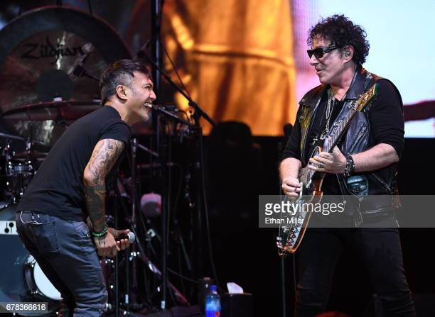 Singer Arnel Pineda and guitarist Neal Schon of Journey perform during the first night of the band's second nineshow residency at The Joint inside...