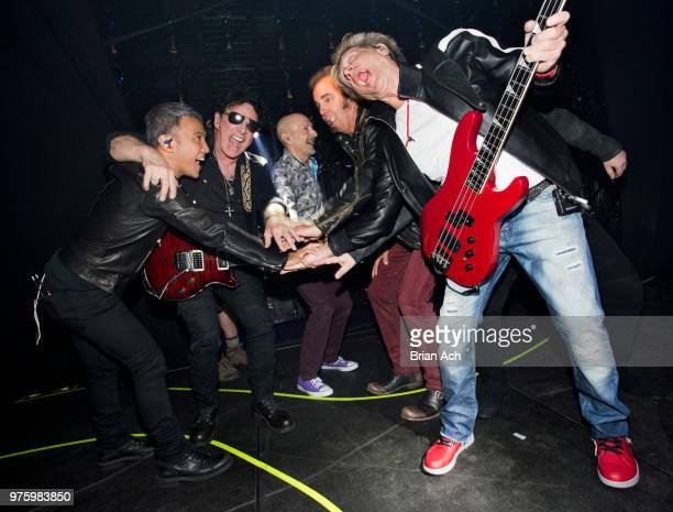 Singer Arnel Pineda founder and guitarist Neal Schon drummer Steve Smith keyboardist Jonathan Cain and bassist Ross Valory of the band Journey are...