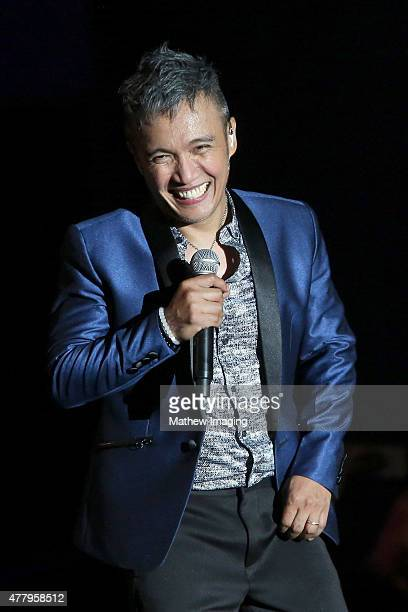 Singer Arnel Pineda of Journey performs onstage during Hollywood Bowl Opening Night 2015 at the Hollywood Bowl on June 20 2015 in Hollywood California