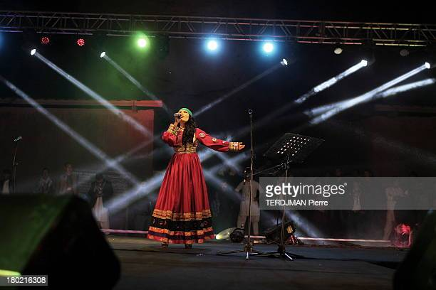 Singer Aryana Sayeed on stage wearing a traditional dress on August 15 2013 in Bamiyan Afghanistan Afghan singer Aryana Sayeed attends a concert of...