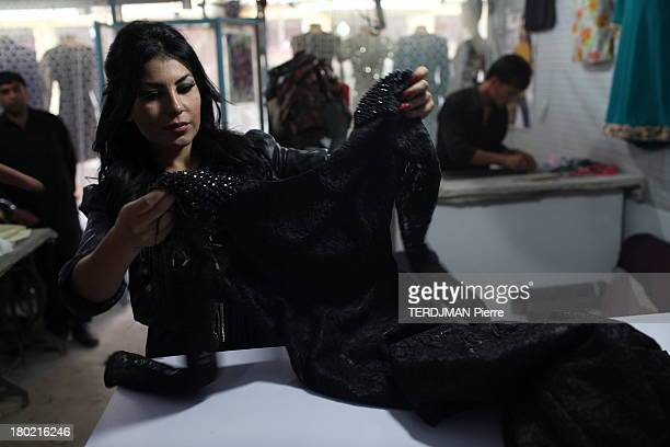 Singer Aryana Sayeed receives the dress she will wear for the Tv Show The Voice of Afghanistan on August 17 2013 in Kabul Afghanistan The Voice of...
