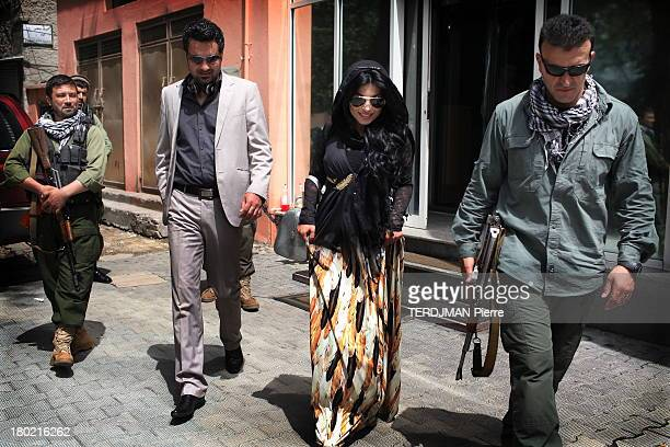 Singer Aryana Sayeed walks in the street on August 17 2013 in KabulAfghanistan Afghan singer Aryana Sayeed attends a concert of young Afghans...