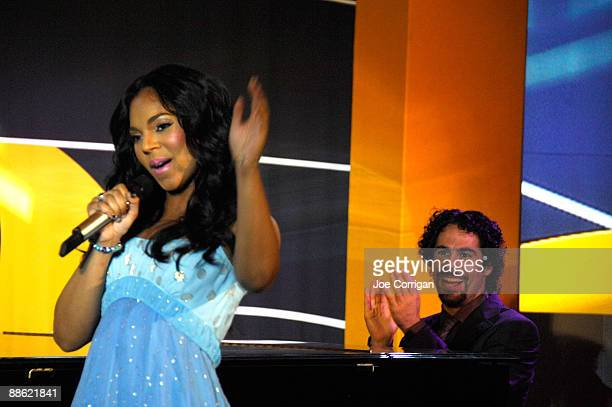 Singer Ashanti and pianist Alex Lacamoire perform during a check presentation to the Century 21 Path to Your Dreams Sweepstakes Winner at Grand...