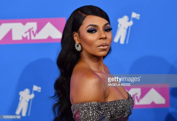 US singer Ashanti attends the 2018 MTV Video Music Awards at Radio City Music Hall on August 20 2018 in New York City / The erroneous mention...