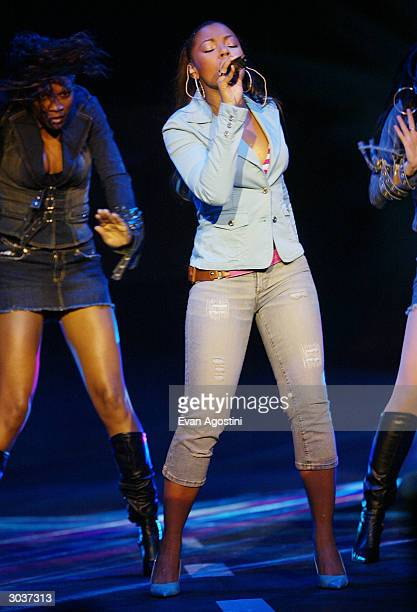 Singer Ashanti performs at Fuse and Hot 97's Full Frontal Hip-Hop fashion showcase at Webster Hall March 2, 2004 in New York City.