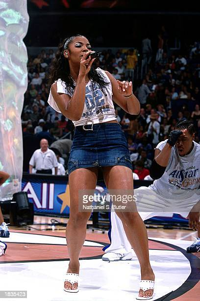 Singer Ashanti performs during halftime of the 2002 WNBA AllStar Game at the MCI Center on July 15 2002 in Washington DC NOTE TO USER User expressly...