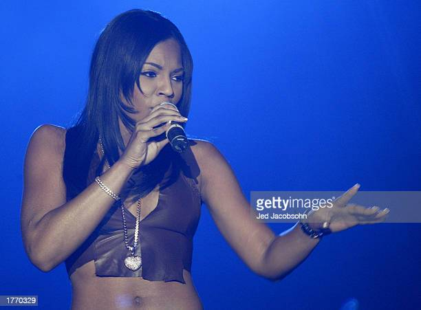 Singer Ashanti performs during the 9th Annual Holyfield Foundation Main Event AllStar Weekend concert at the Georgia World Congress Center on...