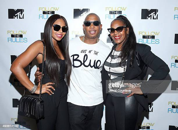 Singer Ashanti Rapper Ja Rule and Tina Douglas attend the MTV And Ja Rule Follow The Rules Premiere Party at Catch on October 21 2015 in New York City