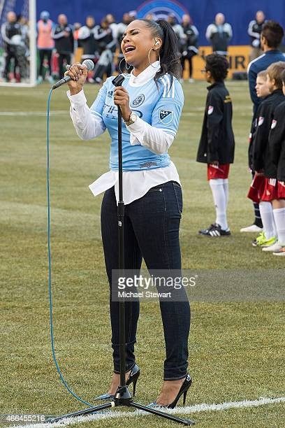 Singer Ashanti sings the national anthem before the New England Revolution Vs The New York City Football Club Match at Yankee Stadium on March 15...