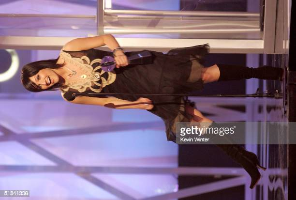 Singer Ashlee Simpson accepts her award for Female New Artist of the Year on stage during the 2004 Billboard Music Awards at the MGM Grand Arena on...
