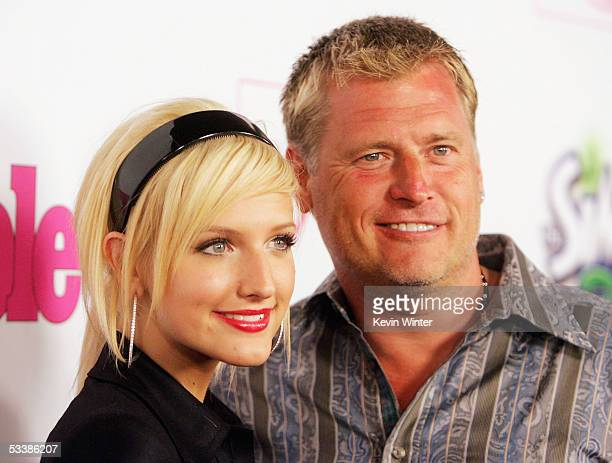 """Singer Ashlee Simpson and her father, manager Joe Simpson, arrive at Teen People's 2nd Annual """"Young Hollywood"""" party at Cabana Club on August 13,..."""