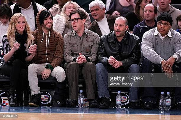 Singer Ashlee Simpson musician Pete Wentz of Fall Out Boy Alan Cumming with guest and LL Cool J attend NJ Nets vs NY Knicks game at Madison Square...