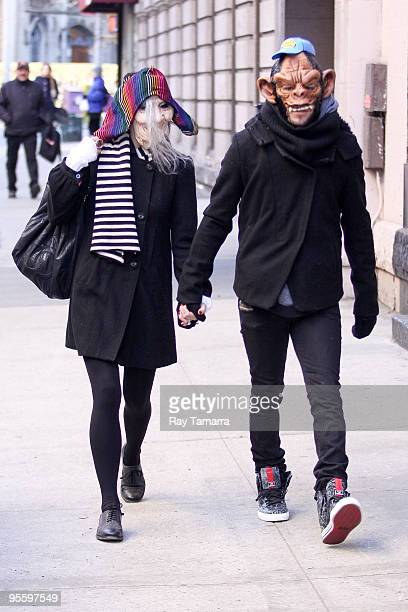 Singer Ashlee Simpson Wentz and musician Pete Wentz wear masks as they walk in Manhattan on January 5, 2010 in New York City.