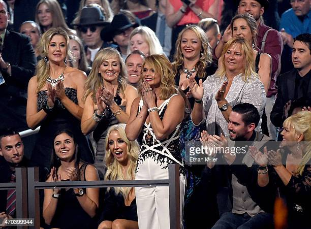 Singer Ashley Monroe cheers on honoree Miranda Lambert winner of the award for Female Vocalist of the Year during the 50th Academy of Country Music...