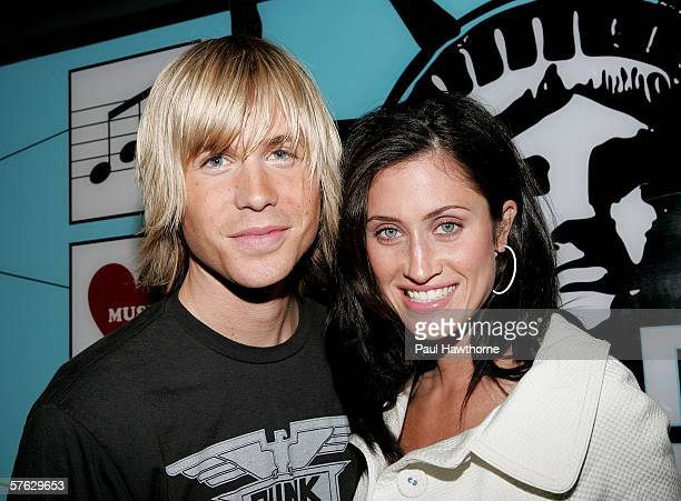 Singer Ashley Parker Angel poses backstage with his wife Tiffany Lynn after appearing on MTV's Total Request Live at MTV Times Square Studios May 16...