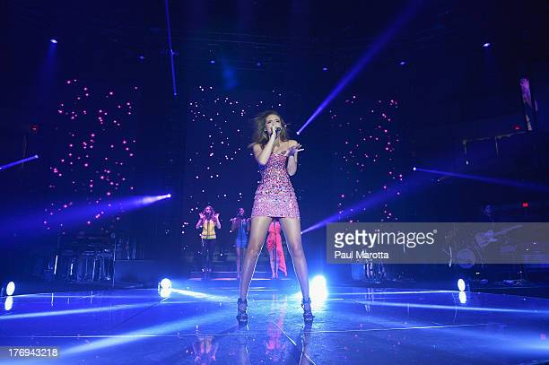Singer Aubrey Cleland performs during American Idol Live 2013 at Agganis Arena at Boston University on August 19 2013 in Boston Massachusetts