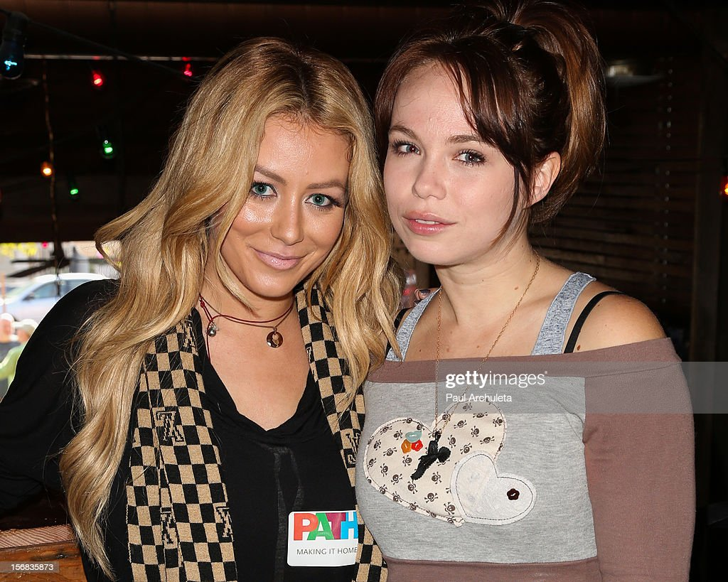 Singer Aubrey O'Day (L) and Actress Amanda Fuller (R) attend PATH's 4th Annual Thanksgiving Meal at Pink Taco on November 22, 2012 in Los Angeles, California.