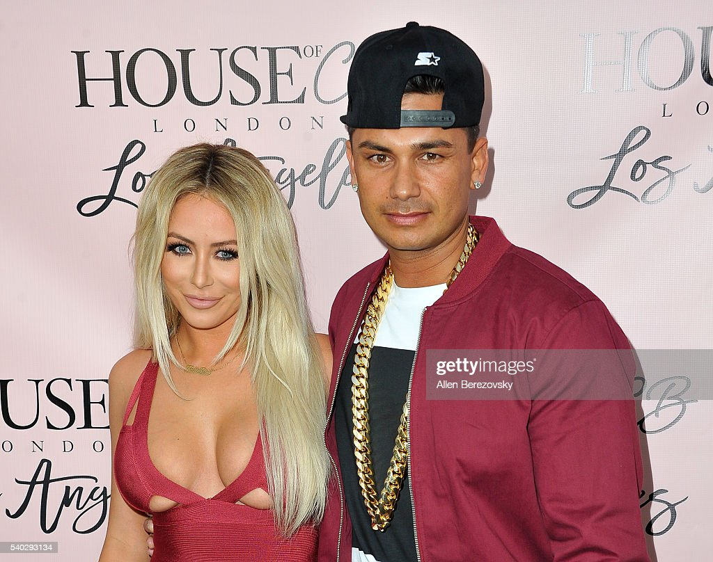 Singer Aubrey O'Day (L) and DJ Pauly D attend the House of CB Flagship Store Launch party at the House of CB on June 14, 2016 in West Hollywood, California.