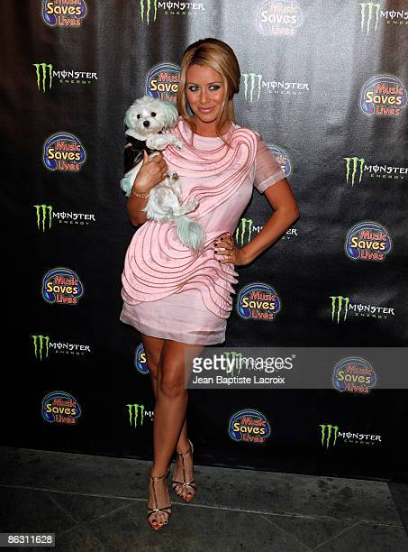 Singer Aubrey O'Day and her dog Ginger arrive at the 4th Annual Music Saves Lives Event at the Key Club on April 30, 2009 in West Hollywood,...