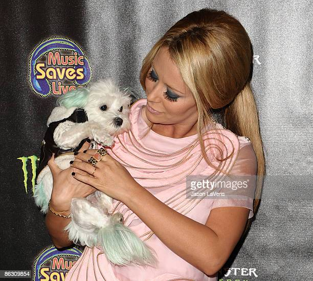 Singer Aubrey O'Day and her dog Ginger attend the 4th annual Music Saves Lives event at the Key Club on April 30, 2009 in West Hollywood, California.