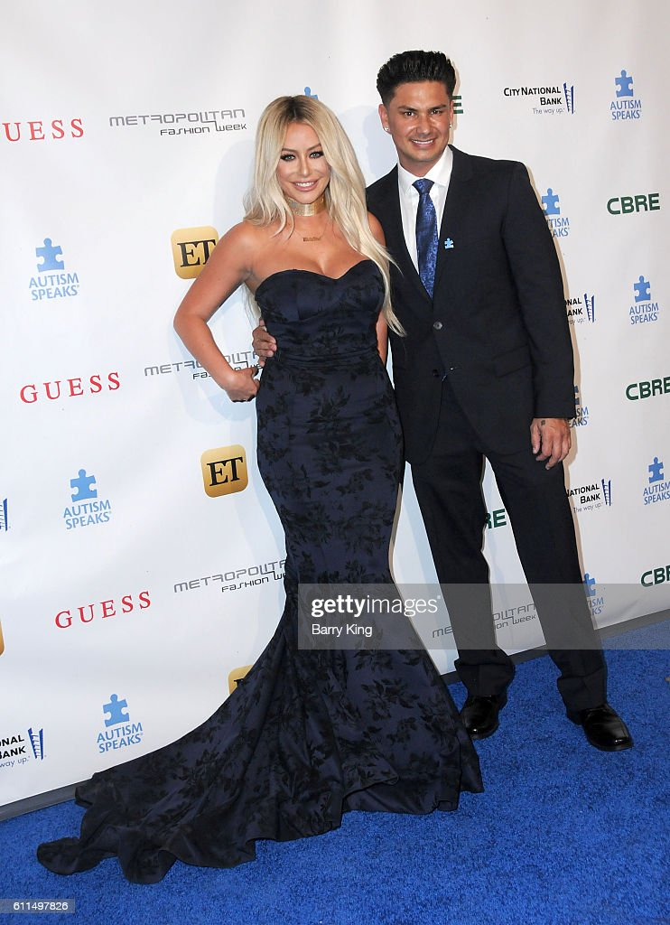 Singer Aubrey O'Day and TV personality/DJ Pauly D, aka Paul DelVecchio attends Metropolitan Fashion Week 2016- La Vie En Bleu - Signature event benefiting Autism Speaks at Warner Bros. Studios on September 29, 2016 in Burbank, California.