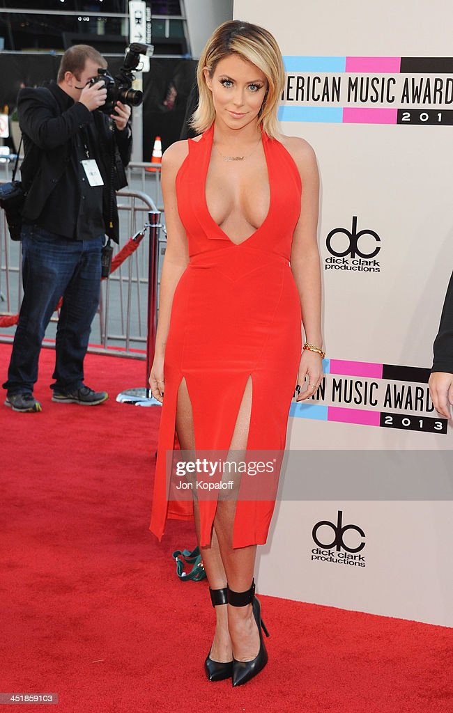 Singer Aubrey O'Day arrives at the 2013 American Music Awards at Nokia Theatre L.A. Live on November 24, 2013 in Los Angeles, California.