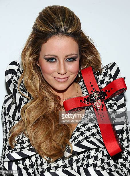 Singer Aubrey O'Day attends The Blonds Fall 2011 fashion show during Mercedes-Benz Fashion Week at Milk Studios on February 16, 2011 in New York City.