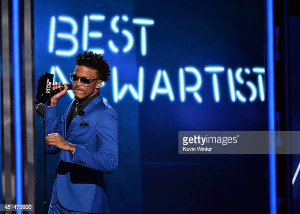 Singer August Alsina accepts Best New Artist onstage during the BET AWARDS '14 at Nokia Theatre LA LIVE on June 29 2014 in Los Angeles California