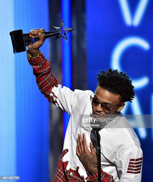 Singer August Alsina accepts the Viewers Choice Award for 'I Luv This' onstage during the BET AWARDS '14 at Nokia Theatre LA LIVE on June 29 2014 in...