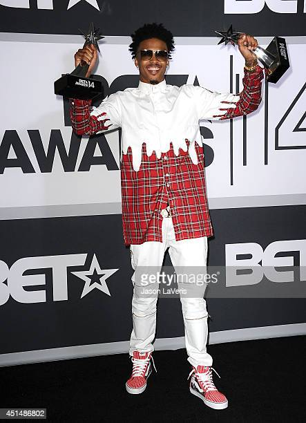 Singer August Alsina poses in the press room at the 2014 BET Awards at Nokia Plaza LA LIVE on June 29 2014 in Los Angeles California