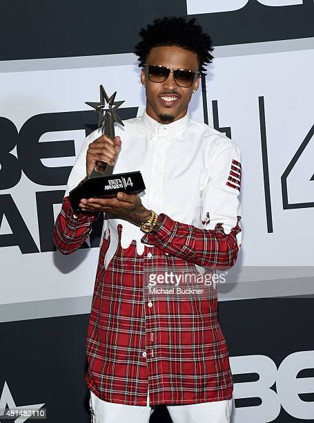 Singer August Alsina poses in the press room during the BET AWARDS '14 at Nokia Theatre LA LIVE on June 29 2014 in Los Angeles California