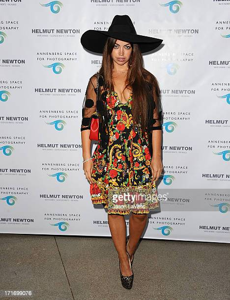 Singer Aura Dione attends the opening of 'Helmut Newton White Women Sleepless Nights Big Nudes' at Annenberg Space For Photography on June 27 2013 in...