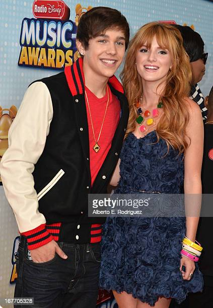 Singer Austin Mahone and actress Bella Thorne arrive to the 2013 Radio Disney Music Awards at Nokia Theatre LA Live on April 27 2013 in Los Angeles...