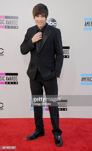 Singer Austin Mahone arrives at the 2013 American Music Awards at Nokia Theatre LA Live on November 24 2013 in Los Angeles California
