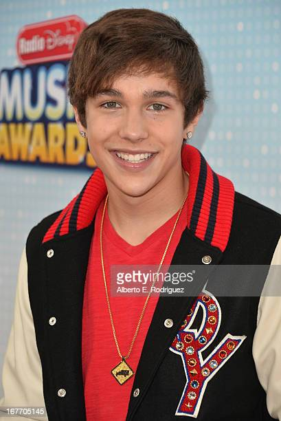 Singer Austin Mahone arrives to the 2013 Radio Disney Music Awards at Nokia Theatre LA Live on April 27 2013 in Los Angeles California