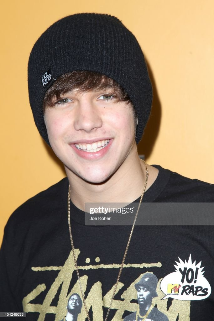 Singer Austin Mahone attends The Salvation Army's 4th Annual Rock The Red Kettle Concert at 5 Towers Outdoor Concert Arena on December 7, 2013 in Universal City, California.