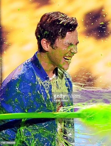 Singer Austin Mahone gets slimed onstage during Nickelodeon's 27th Annual Kids' Choice Awards held at USC Galen Center on March 29 2014 in Los...