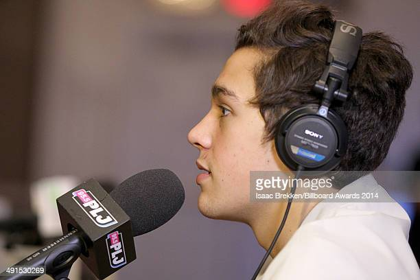 Singer Austin Mahone is interviewed backstage at Radio Row during the 2014 Billboard Music Awards at the MGM Grand Garden Arena on May 16 2014 in Las...