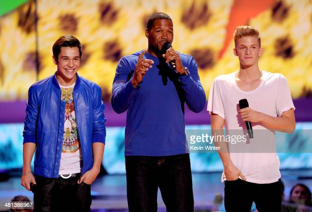 Singer Austin Mahone Michael Strahan and singer Cody Simpson onstage during Nickelodeon's 27th Annual Kids' Choice Awards held at USC Galen Center on...