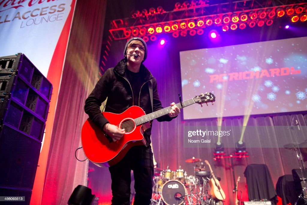 Singer Austin Mahone performs at the Z100 & Coca-Cola All Access Lounge at Z100?s Jingle Ball 2013 pre-show at Hammerstein Ballroom on December 13, 2013 in New York City.